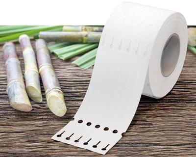 Mit den neuen Zuckerrohr-basierten Schlaufenetiketten bietet Güse eine umweltfreundliche Alternative an (Quelle: Güse GmbH)